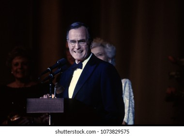 Washington DC., USA, January 20, 1989 President George H.W. Bush addresses the crowd gathered at one of the inaugural balls to celebrate his campaign victory First Lady Barbara Bush is behind him