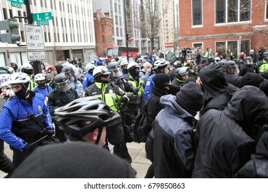 Washington, D.C., USA - January 20, 2017:  Police and anti-fascist, anti-Donald Trump protesters face off at the end of a march through downtown on Inauguration Day.