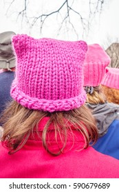 WASHINGTON, DC, USA – JANUARY 21, 2017: Close-up of pink hats worn by protesters listening to speeches at the Women's March in Washington, DC.