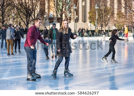Washington DC, USA - January 28, 2017: Couple skating in ice rink in National Gallery of Art Sculpture garden