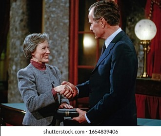 Washington, DC. USA, January 3, 1985  Vice President George H.W. Bush shakes hands with Senator Nancy Kassebaum (R-KS) after swearing her on the opening day of the 99th Congress.