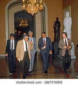 Washington DC. USA, January 9, 1985 (Center) L-R Senators Ellis Abdnor (R-SD) Rudy Boschwitz (R-MN) and Robert Dole (R-KS) walk to  the Ohio clock to talk with reporters about the budget meeting