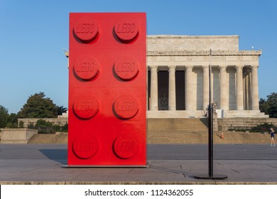 Washington, DC / USA - July 1, 2018: The 60th Anniversary LEGO Brick is on display in Washington, DC. It is 10 feet tall, made of 133,000 bricks, and weighs  925 pounds.