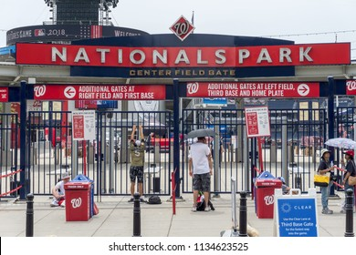 Washington, DC / USA: July 15, 2018: Fans wait outside Washington Nationals Park during the week of events leading up to the 2018 Major League Baseball All-Star Game.