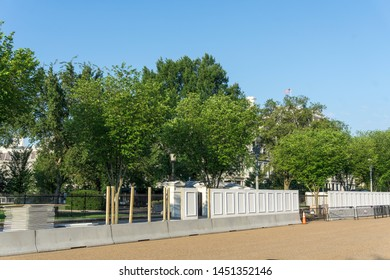 Washington, DC / USA - July 15, 2019: Construction has begun on a new, taller, and more secure White House fence.