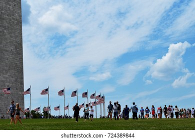 WASHINGTON D.C, USA - JULY 15, 2017 : People walk among American flags in Washington Monument in D.C.