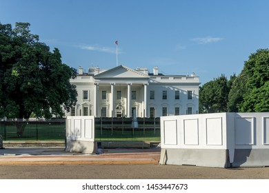 Washington, DC / USA - July 17, 2019: construction continues to the replace old the fence surrounding the White House with a taller, more secure fence.