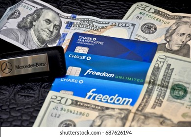 WASHINGTON DC, USA - JULY 31, 2017: Credit cards and United States cash sitting in a pile.
