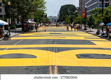 Washington, DC, USA - July 6, 2020:  Black Lives Matter Plaza got a new coat of bright yellow paint from the city this morning