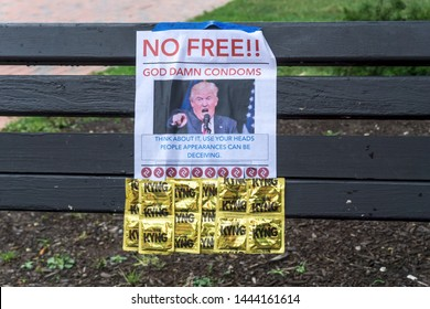 """Washington, DC / USA - July 7, 2019: a different kind of protest at the White House tries to convince people to """"use your heads"""" while giving out free condoms."""