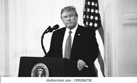 Washington, DC / USA - July 9 2018: USA President Donald Trump in the Supreme Court of the United States, serious angry look during a speech, black and white