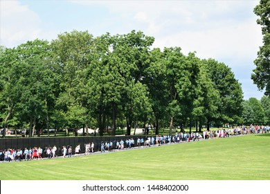 WASHINGTON, D.C. USA - Jun 06,2018; The tourists visited Vietnam Veterans Memorial in Washington, DC and  there were 58,267 names listed on the long black memorial wall.