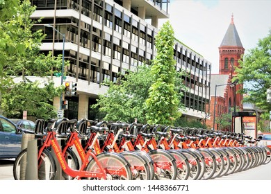 Washington, D.C ,USA - June 06,2018 ; Public rental Red CAPITAL BIKESHARE lined up infront of Smithsonian Castle in Washington, D.C. United States