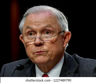 Washington DC, USA, June 13, 2018 Attorney General Jeff Sessions reads from prepared answers in response to a question of the Senate Intelligence Committee during  testimony in front of the Committee