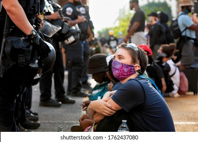 Washington, DC, USA - June 23, 2020: Metropolitan Police of Washington face off against sitting peaceful protesters to prohibit access to Lafayette Square and the statue of Andrew Jackson