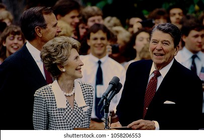Washington, DC., USA, June 3, 1987 President Ronald Reagan and First Lady Nancy Reagan along with Vice-President Goerge H.W. Bush at podium on South lawn of the White House prior to departure on trip
