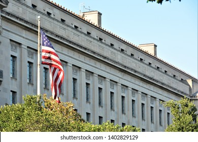 Washington D.C. USA. June 3, 2017. Department of Justice building located in Washington D.C. on a nice sunny day with the United States Flag.