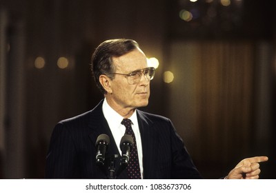 Washington DC, USA, June 4, 1992 President George H.W. Bush answers reporters questions during news conference in the East Room of the White House
