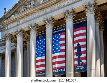 Washington DC, USA - June 5, 2018: Close up looking up at the pillars and exhibit sign on the National Archive building facing Constitution Avenue