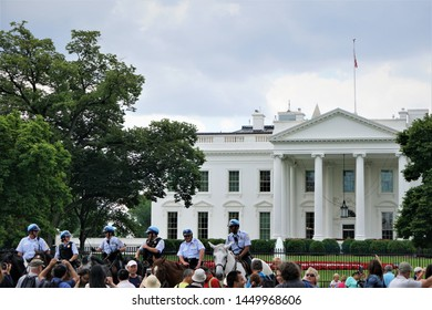Washington, D.C, USA - June 6,2018 ; The White House building with the mounted police or cavalry cop. are on the horseback lined up and tourists are standing and enjoy watching them.