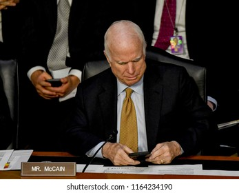 Washington DC. USA. June 8, 2017Senator John McCain (R-AZ) reads a text message during former FBI Director James Comey's testimony during his hearing in front of the Senate Intelligence Committee