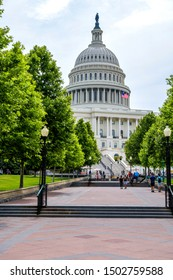 Washington, D.C., USA - June 8, 2019: A sunny Spring morning view of a broad sidewalk at west-front of U.S. Capitol Building, the home of the nation's legislature and a popular tourist destination.