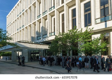 WASHINGTON, DC, USA - June 8, 2017: Visitors wait in line to get into the Senate office building to see James Comey testify in front of the Senate Intelligence Committee today.