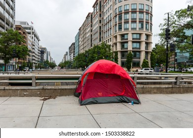 Washington DC, USA - June 9, 2019: Homeless persons tent in the city  on the pedestrian walkway. Washington has a number of homeless that sleep outdoors, although tent is unusual sight