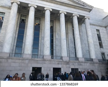Washington, D.C., USA - March 13, 2019: People waiting in line to enter the Rayburn House Office Building on Capitol Hill in Washington DC