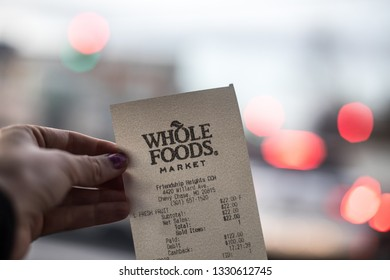 Washington, D.C. / USA - March 2, 2019: A receipt on recycled paper from Whole Foods shows the purchases made by a buyer. Whole Foods is an American USDA Certified Organic supermarket chain store.