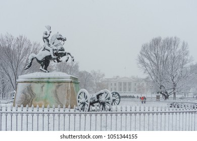Washington, DC / USA - March 21, 2018: The White House is covered in snow during a spring snowstorm.