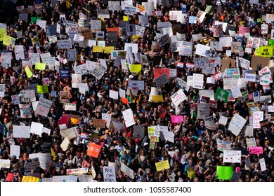 Washington DC / USA - March 24, 2018: Close up of a Group of Protesters with Signs Marching on Pennsylvania Ave at the March for Our Lives