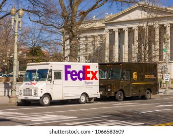 WASHINGTON, DC, USA - MARCH 24, 2009: Fedex and UPS delivery trucks at United States Treasury building.
