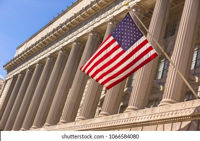 WASHINGTON, DC, USA - MARCH 24, 2009: Flag and columns at U. S. Department of Commerce building.