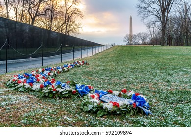 Washington, DC, USA -- March 3, 2017: A dusting of snow coats wreaths just outside the Vietnam Veterans Memorial as Washington, DC received its first snow of 2017.
