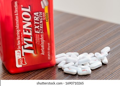 Washington, D.C. / USA - March 31, 2020: Bottle Of Tylenol Extra Strength With Many Pills On A Wooden Table Which Was Sold Out During Covid-19 time