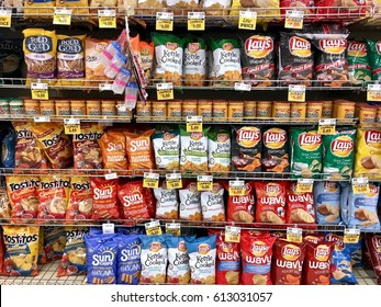 WASHINGTON DC, USA - MARCH 31, 2017: Baked chips in the snack food isle at a grocery store.