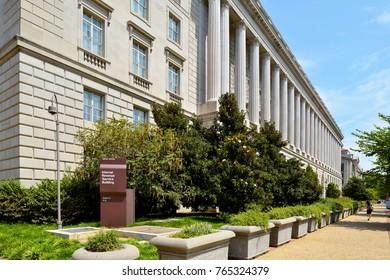 WASHINGTON, DC, USA - MARCH 4, 2012: A woman walks by the Internal Revenue Service building in Washington, DC.