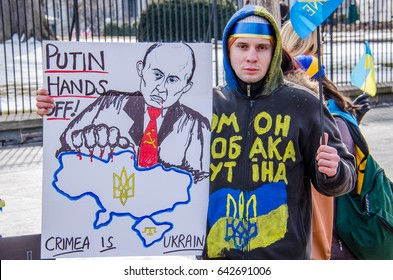 Washington DC, USA - March 6, 2014: Closeup of man with sign about Russia and Putin during Ukrainian protest by White House