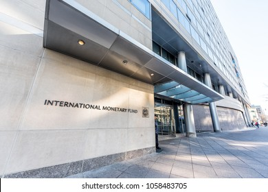 Washington DC, USA - March 9, 2018: IMF entrance with sign of International Monetary Fund, concrete architecture building wall security guard doors