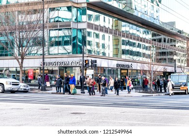 Washington DC, USA - March 9, 2018: Nordstrom rack store sign entrance shop in capital city street exterior, many people crossing urban crosswalk at intersection