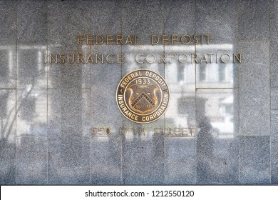 Washington DC, USA - March 9, 2018: Closeup of FDIC United States Federal Deposit Insurance Corporation sign on wall of headquarters building with logo on 17th street, nobody