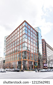 Washington DC, USA - March 9, 2018: 1200 17th Street NW modern building in capital city of United States with red color and glass windows, Democracy Fund, Pillsbury offices, intersection