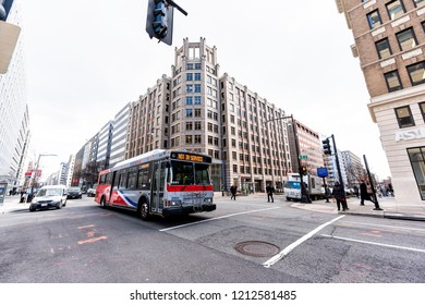 Washington DC, USA - March 9, 2018: Street road in Farragut West neighborhood of city, building exterior facade office during day, architecture, metrobus, intersection