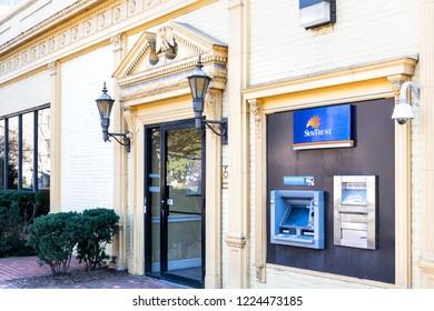 Washington DC, USA - March 9, 2018: Suntrust bank, banking branch, office building entrance at Dupont Circle, no people, nobody, ATM, depository slot, door