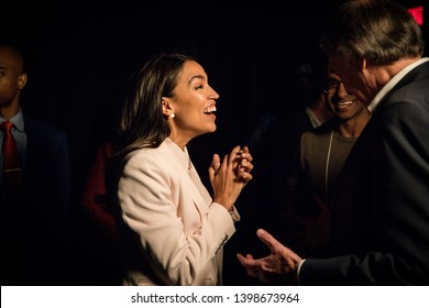 Washington, DC/ USA - May 13, 2019: Senator Bernie Sanders and Representative Alexandria Ocasio Cortez speak about the importance of a Green New Deal at a town hall organized by the Sunrise Movement.