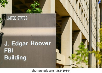 WASHINGTON DC, USA - MAY 2, 2015: Sign displaying J. Edgar Hoover FBI Building, in front of the Headquarters of the Federal Bureau of Investigation.