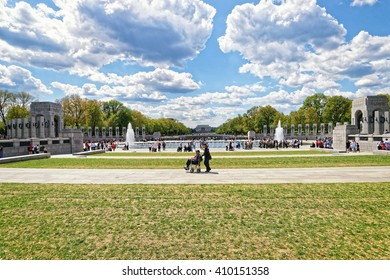 Washington DC, USA - May 2, 2015: Tourists and War Veterans and guardians of Honor Flight nonprofit organization in National World War 2 Memorial, National Mall. Lincoln memorial on the background.