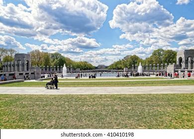 Washington DC, USA - May 2, 2015: War Veterans and guardians of Honor Flight nonprofit organization at National World War 2 Memorial, National Mall. Lincoln memorial on the background.