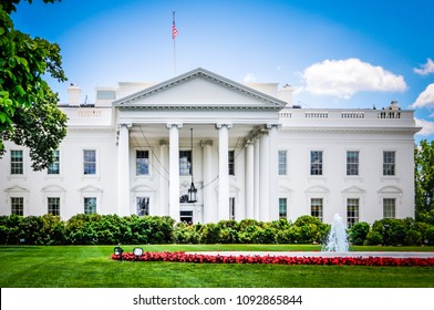 Washington, DC / USA - May 23 2014: The White House, the residence of the president of the United States with the green lawn and flowers in the front.